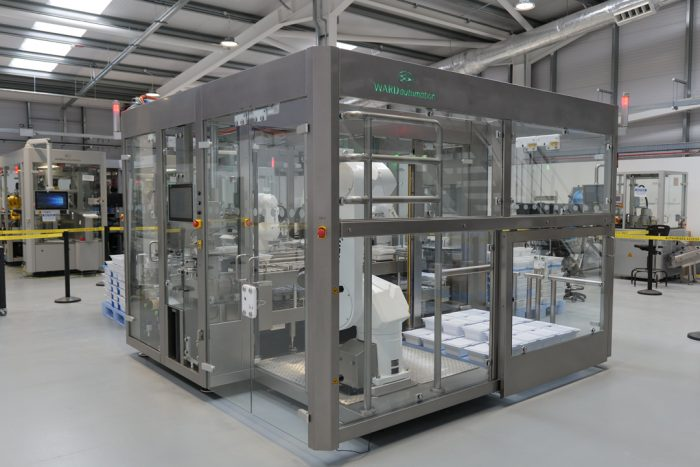 Pre-filled syringe tub inspection, labelling, lidding and palletising machine